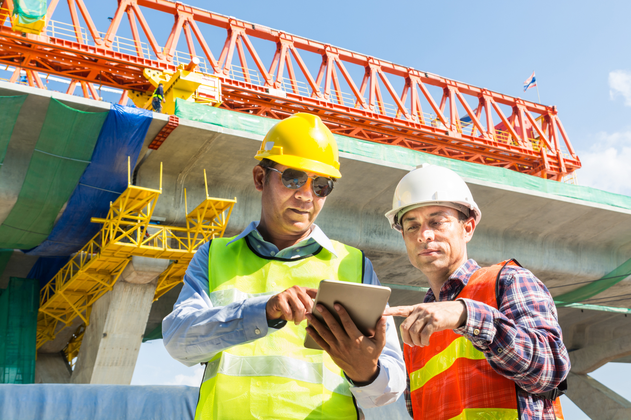 Architect-and-Engineer-working-Together-with-Digital-Wireless-Tablet-956818350_2125x1416