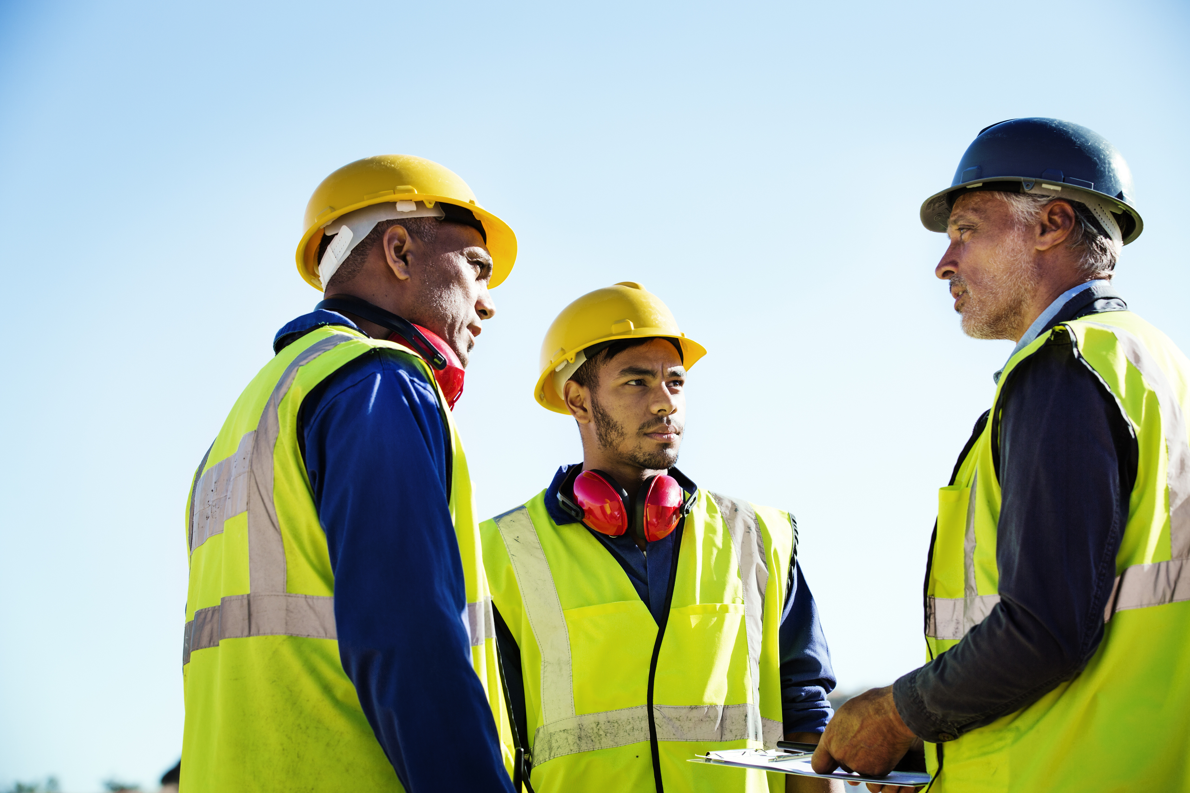 Architect-discussing-with-quarry-workers-551349559_3869x2580-1